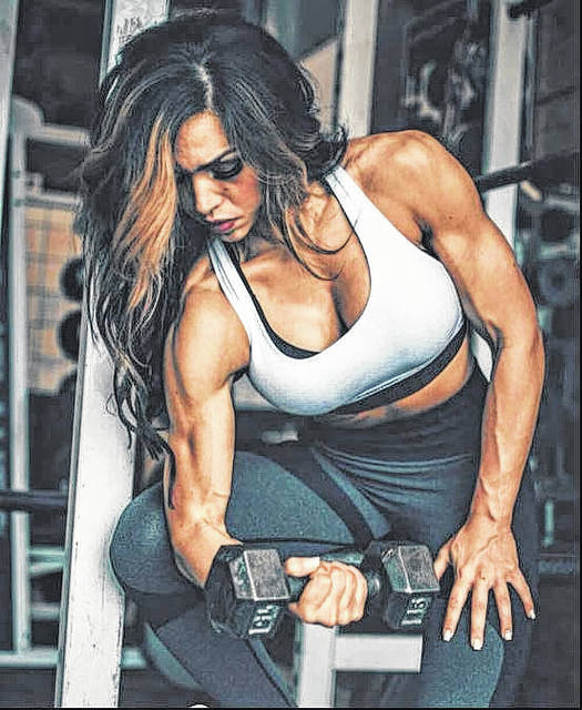 Shantelle Rathburn is seen curling. She will be competing in the bodybuilding 2018 NPC Mountaineer Classic at the Charleston Civic Center this Saturday.