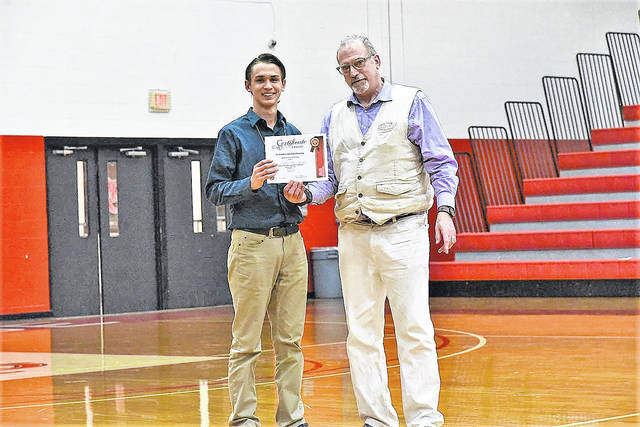 University of Rio Grande and Rio Grande Community College Provost Dr. Richard Sax presents Fairland High School student Sebastian Davies with the Rio Grande Science Day Scholarship. High school students from Gallia, Lawrence, Pike, and Scioto counties came to Rio's campus for the annual District 14 Science Day.