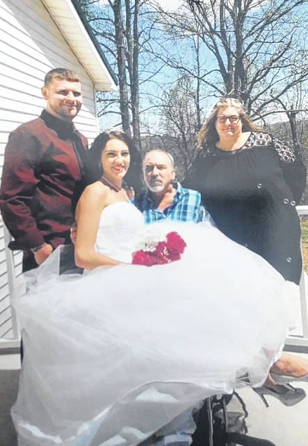 From left to right are Gregory Musser, Linda Musser, George Sheets and Gladys Grimmett-Sheets. George was able take his daughter down the aisle of his wedding after three months of battling an infection which affected his mobility.