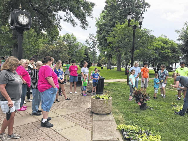 Gallipolis in Bloom held its annual planting day Saturday morning with a plant exchange just prior to volunteers gathering and planting across town. Volunteers were counted to number around 50 and planting took roughly 45 minutes due to all the volunteers, said GIB committee members.