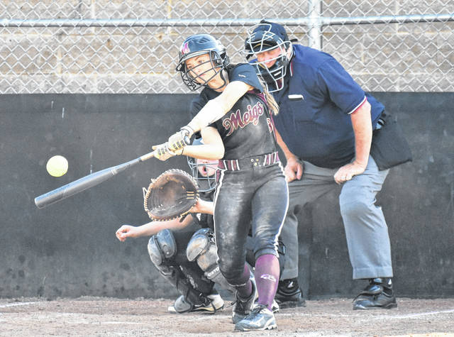 Meigs junior Taylor Swatrz drives a hit during the second inning of the Lady Marauders' 10-0 win over Crooksville in a Division III sectional semifinal contest on Tuesday in Rocksprings, Ohio.