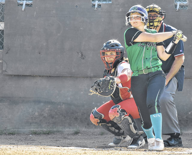 EHS freshman Tessa Rockhold lifts a homer during the second inning of the Lady Eagles' 15-5 victory over South Webster in a Southeast District Division IV sectional final contest on Thursday in Tuppers Plains, Ohio.