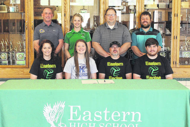 On May 7 at Eastern High School, senior Morgain Little signed her National Letter of Intent to join the Kent State Tuscarawas volleyball team. Sitting in the front row, from left, are Shilo Little, Morgain Little, Adam Little and Austin Little. Standing in the back row are KSU-T Athletic Director Rob Brindley, former EHS volleyball coach Katie Williams, EHS Principal Shawn Bush, and Eastern athletic director Joshua Mummey.