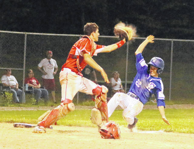 Gallia Academy junior Bo Saxon, right, slides into home during a force out in the seventh inning of Monday night's Division II district semifinal baseball contest against Hillsboro at Rannow Field on the campus of Athens High School in The Plains, Ohio.