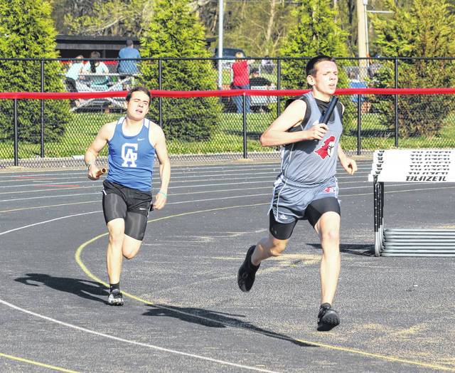 Point Pleasant sophomore Peyton Hughes, right, hits full stride during the 4x800m relay event held at the 2018 Battle for the Anchor on April 30 at OVB Track and Field in Point Pleasant, W.Va.