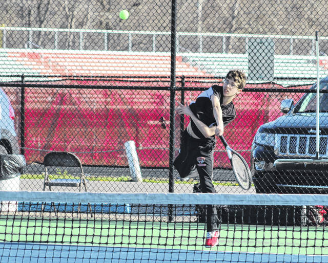 Point Pleasant junior Dawson Wilson hits a serve during an April 11 match against Huntington Saint Joseph at The Courts in Point Pleasant, W.Va.