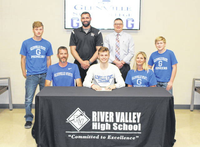River Valley senior Jarret McCarley, seated front and center, will be continuing his basketball career after signing a letter of intent with Glenville State College on Wednesday, May 9, 2018, at RVHS in Bidwell, Ohio. Jarret is joined in front by his parents, Ryan McCarley and Kari Ryan. Standing in back are brother Kaleb Beckner, former RVHS football coach Jerrod Sparling, RVHS Principal T.R. Edwards, and brother Kaden McCutcheon.
