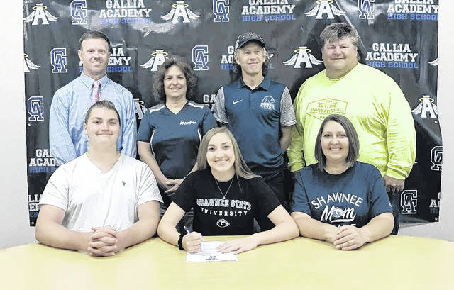 On May 16, 2018, in Gallia Academy High School, senior Cassidy Starnes signed a letter of intent to join the Shawnee State University cross country and track and field teams. Sitting in the front row, from left, are Riley Starnes, Cassidy Starnes and Sherry Starnes. Standing in the back row are Adam Clark, Lori Ward, Eric Putnam and Todd May.