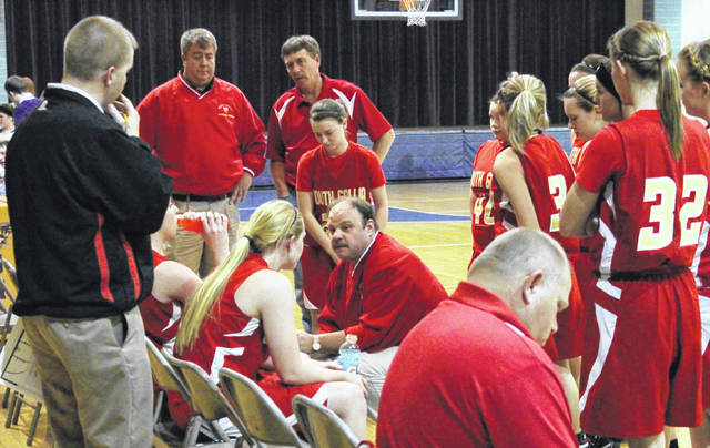 Former South Gallia girls basketball coach Brett Bostic, kneeling in center, talks with his troops during a January 3, 2013, contest against Southern in Racine, Ohio. Bostic was named the varsity boys basketball coach at River Valley on Wednesday night.