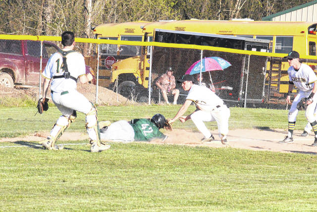 Eastern junior Nate Durst (7) tags out a Waterford runner in front of EHS seniors Kaleb Hill (14) and Christian Mattox (11), during the Eagles' 6-0 victory over Waterford on Tuesday in Tuppers Plains.