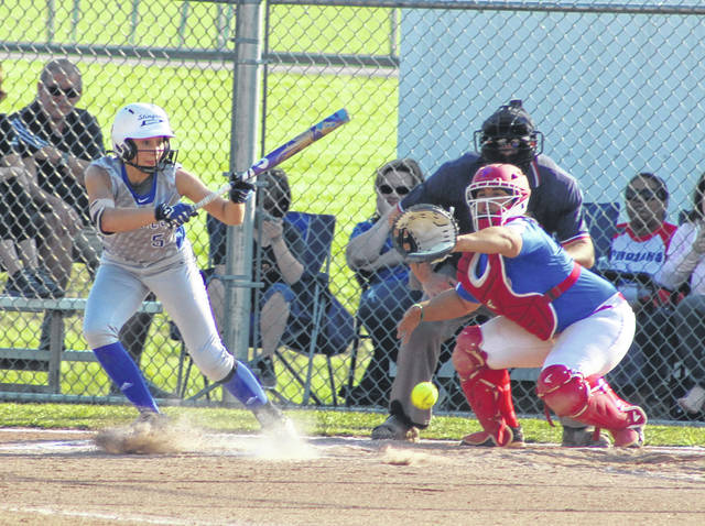 Gallia Academy freshman Bailey Young lays down a bunt during an Ohio Valley Conference softball game against Portsmouth on April 15 at the Eastman Athletic Complex in Centenary, Ohio.