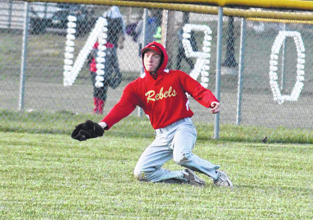 South Gallia senior Wade Luther makes a diving catch in left field during the Rebels' 15-0 loss to Southern on April 19 in Racine, Ohio.