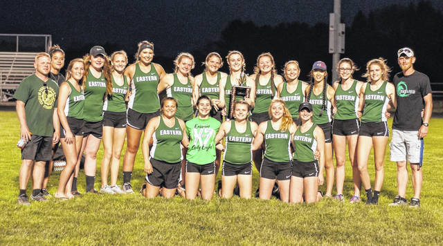 Members of the Eastern girls track and field team pose for a picture after winning the program's ninth consecutive TVC Hocking championship on Thursday night at Vinton County High School in McArthur, Ohio.