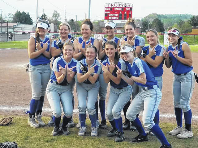 Members of the Gallia Academy softball team pose for a picture after securing a share of the program's first-ever OVC championship on Thursday night following a 13-1 victory over host Portsmouth.