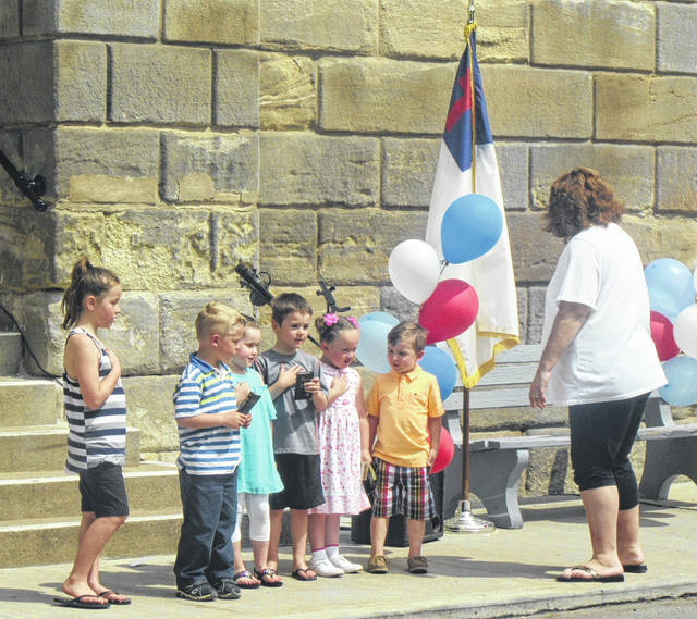 Preschool students from Little Lamb Preschool lead the pledges to the Christian Flag and Bible during the National Day of Prayer event in Meigs County, as well as singing songs for those in attendance.