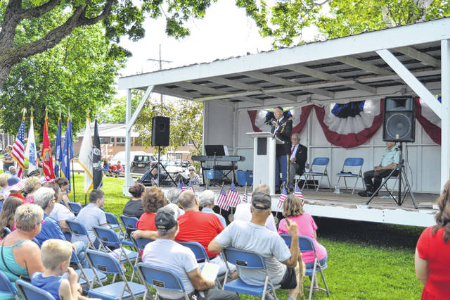 Retired Army Colonel Bob Wetterstroem addresses the assembled in Gallipolis City Park after the Memorial Day Parade.