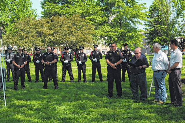 Tony Gallagher, City Commissioner of Gallipolis, read the official proclamation Tuesday afternoon honoring those who have given their lives in service of others for National Peace Officers Memorial Day. The honor guard is seen in the background after having paid respects to three fallen officers.