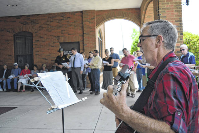 "Gallia County celebrated National Day of Prayer on the Gallia Courthouse steps Thursday with song and prayer as members of the community and Gallia congregations shared fellowship together. Prayers were led by John O'Brien, Jamie Sisson, Heath Jenkins, Josh Bodimer and Barb Williams. Songs were led by John Jenkins. The theme of this year's National Day of Prayer centered around ""Unity"" and Ephesians 4:3. Gallia Commissioners read a proclamation recognizing the day."