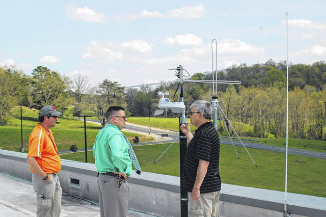 Pictured from left are JP Davis, TR Edwards, and Brett Wilt with the new weather sensor installed at River Valley High School.