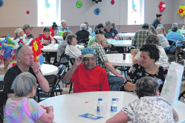 Local citizens enjoy Senior Day at the Gallia County Senior Center, getting a free lunch and enjoying games together.