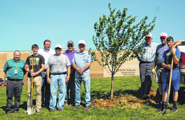 Pictured from left are Principal Bray Shamblin, Jeff Fowler, Kyle Northup, Rick Howell, Henry Dillon, Jim Ryan, Buzz Call, Richard Brown, and Jared Ward.