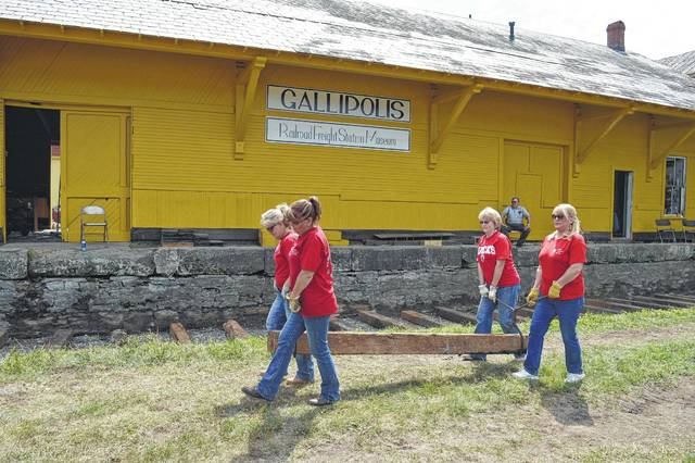 Ohio Valley Bank employees helped lay railroad ties for the Gallipolis Railroad Freight Station Museum last summer. Museum officials say the building's roof replacement is complete and the exterior of the structure is fully painted.