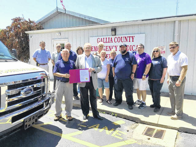 Gallia County Commissioners present the official proclamation to EMS Director Larry Boyer along with some of the paramedics.