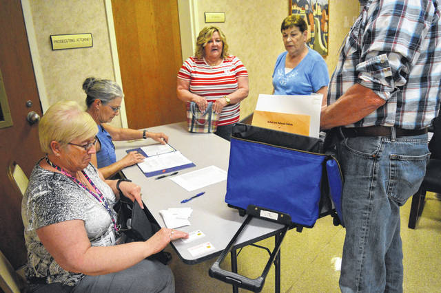 Volunteers and election officials gather on the second floor of the Gallia County Courthouse to collect the final results of Gallia's primary elections.