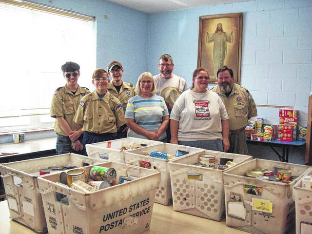 Linda Sager (center) with several Boy Scouts from Troop 201 at Grace United Methodist Church with a portion of the food collected.