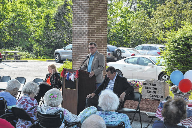 Commissioner Brent Saunders serves a proclamation at Holzer Senior Care recently recognizing National Skilled Nursing Care Week in honor of seniors and individuals of any age with disabilities receiving skilled nursing care throughout centers in Gallia County. The week is recognized from May 13 to 19.
