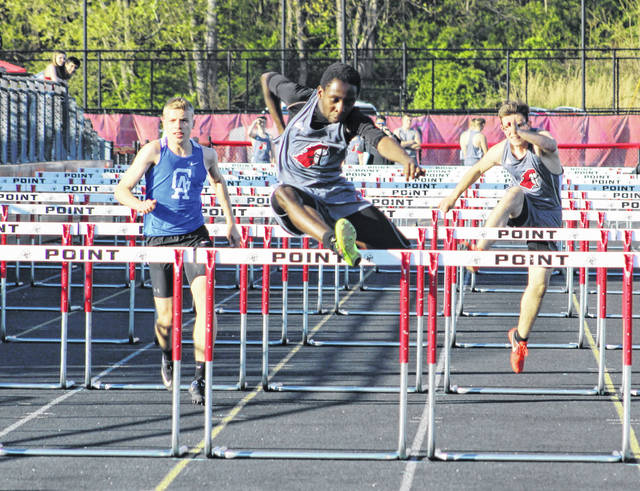 Point Pleasant sophomore Kaydean Eta, center, clears the final obstacle during the 110m hurdles event at the 2018 Battle for the Anchor held at OVB Track and Field on April 30 in Point Pleasant, W.Va.