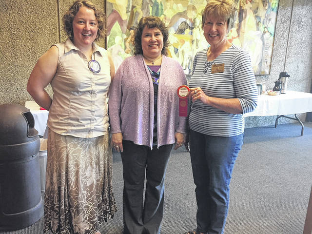 Peggy Saunders installed as new member of the Gallipolis Rotary Club on May 15 by President Jenny Evans assisted by Debbie Rhodes, Past President.
