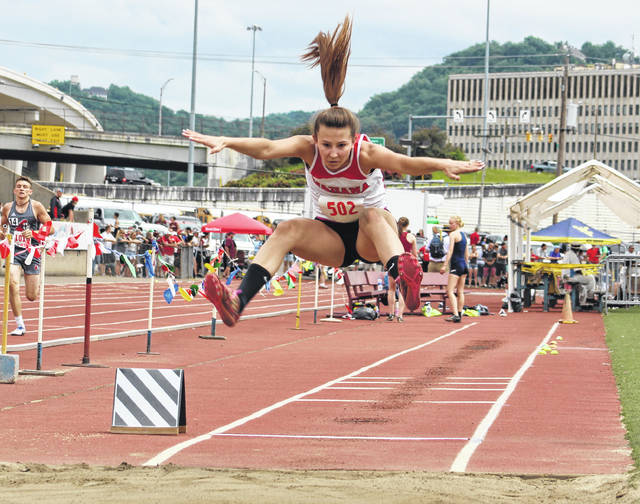 Wahama senior Kaleigh Stewart leaps through the air during the 2018 Class A long jump final held Friday at Laidley Field in Charleston, W.Va.