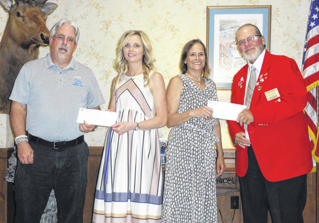 Pictured are Exalted Ruler Bob Marchi and PER Walton Brown, representing the Gallipolis Elks, presenting cerebral palsy grant checks to Suzanne Eachus, principal, Guiding Hand School, Gallia County Board of Developmental Disabilities and Kay Davis, superintendent, Meigs County Board of Developmental Disabilities.