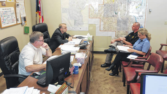 Gallia Commissioners and the Gallia Sheriff's Office discuss the increased capacities and needs of the Gallia correctional program. From left to right are Commissioner Brent Saunders, Commissioner David Smith, Gallia Sheriff Matt Champlin and Gallia Sheriff's Office, Office Administrator Heather Casto. Not pictured, Commissioner Harold Montgomery.