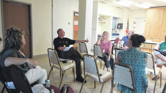 Gallia Sheriff Matt Champlin discusses with area behavioral health service providers about a developing rapid response team to address substance abuse.