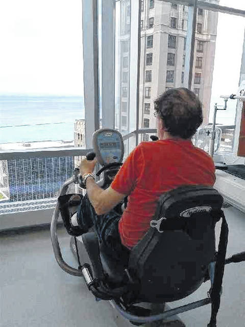 Mike Brown overlooks Lake Michigan as he exercises.
