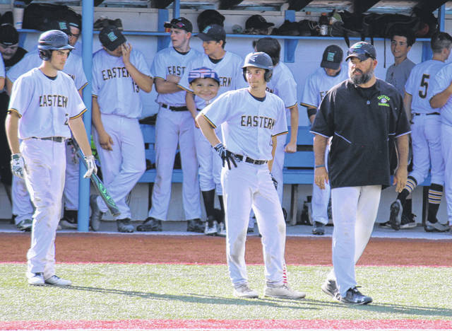 Eastern head coach Brian Bowen (right) talks with seniors Austin Coleman (center) and Ethen Richmond (left) during the Division IV Region 15 championship game on May 25 in Lancaster, Ohio.