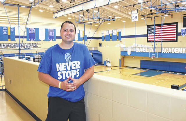 Gallia Academy girls basketball coach Jordan Deel stands at the top of the gymnasium, following an open gym workout on Thursday in Centenary, Ohio.