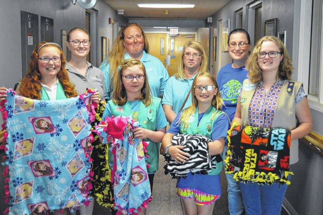 From left to right in front are Brynna Dodrill, Cassie Puckett, Maggie Simmons, Havanah Grube. From left to right in back are Sarah Meucci, Nichole Dodrill, Shellie Puckett, Jennifer Robertson. Girl Scout Troop 201 donates blankets to the Bright Beginnings Unit at Pleasant Valley Hospital.