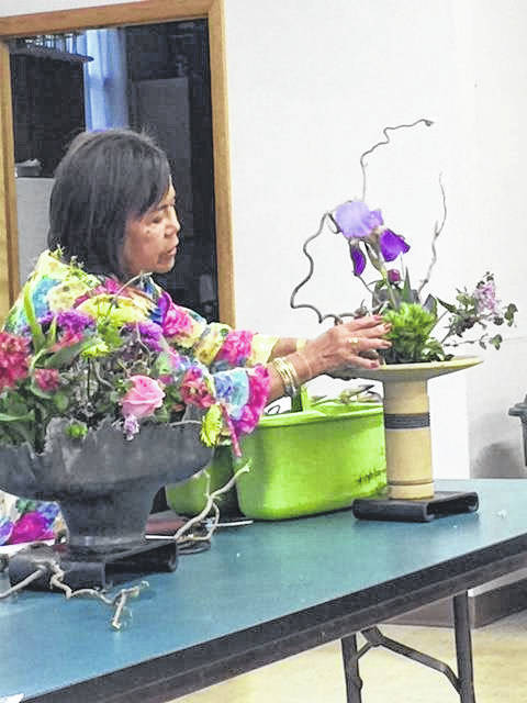 Lydia Simon arranges flowers