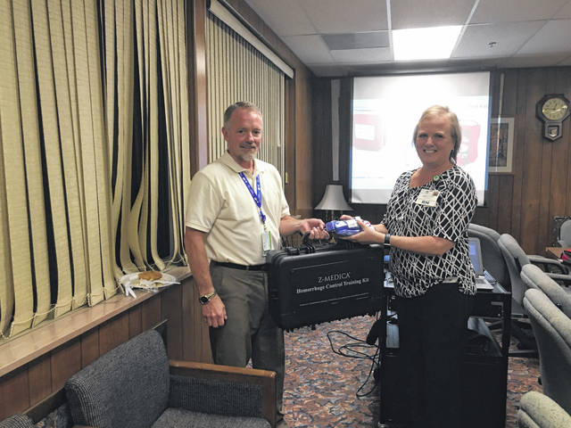 Doug Douglas presented Jackie Stewart with a Z-Medica Hemorrhage Control Training Kit to be used at PVH.