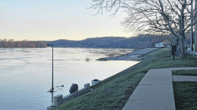 The sun sets along the Ohio River at Gallipolis on an evening last February when much of southeast Ohio was flooding.