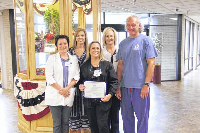 Pleasant Valley Hospital (PVH) Emergency and Trauma Center recently earned the Level IV Trauma Center designation from the State of West Virginia. Pictured are Kelly Doczi, RN, Emergency Department Nurse Manager, Crystal Tolley, Executive Director Physician Practice Services, Gina Byus, RN, Trauma Program coordinator, Amber Findley, Chief Nursing Officer, and James Toothman, DO, Chief of Emergency Medicine.