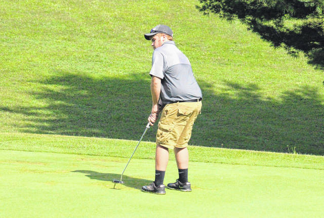 Wyatt Nicholson putts on the second green at the Meigs County Golf Course, during the Capehart golf league on June 25 in Pomeroy, Ohio.