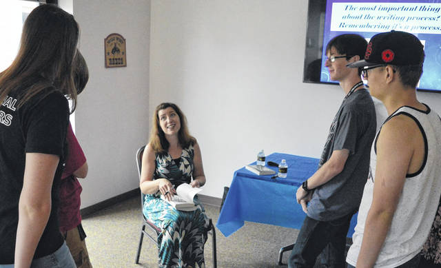 Young adult author Natalie Richards meets with area teens Thursday afternoon as part of a writing workshop discussing the profession of writing, how to go about being published and developing plots.