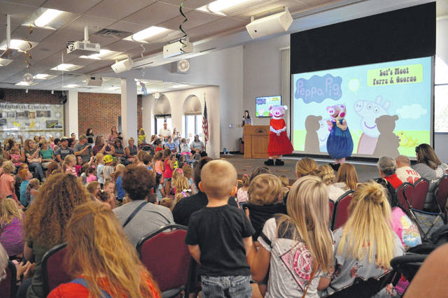 Bossard Memorial Library had Peppa Pig and her brother George visit the Riverside Room Wednesday afternoon for story time. Around 570 parents and children visited the event with a line wrapping around the corner of the library with families waiting to see the characters.