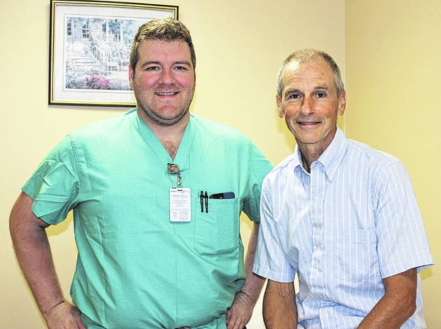 Dr. Andrew Dittenhofer, Holzer General Surgeon, is shown pictured with Bob Davidson, who recently shared his experience as a hernia surgery patient.