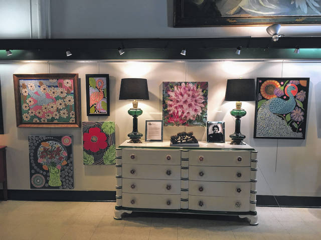 An original chest of drawers designed by Dorothy Draper surrounded by items making it reminiscent of The Greenbrier.