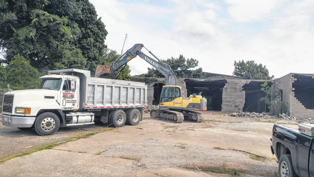 Demolition of the old Willis Tire building, pictured here, started Monday. Bossard Memorial Library intends to build a parking lot in that location, initially.
